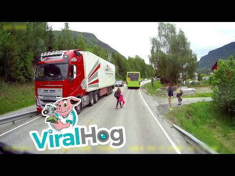 Semi Truck Narrowly Misses Kids Crossing Street    ViralHog
