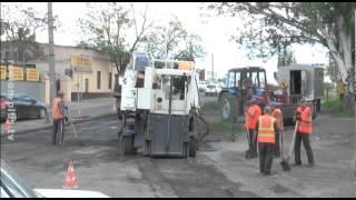 «Фронтовые» дороги(В Мелитополе завершилась двухлетняя эпопея с ремонтом асфальтного покрытия в районе остановки маршрутных..., 2015-05-12T12:18:53.000Z)