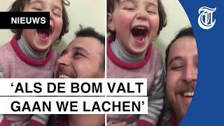 Ontroerende beelden: Syrische vader laat dochter lachen om vallende bommen