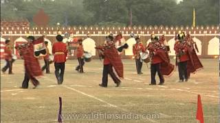 Army unit with music instrument performing a march past