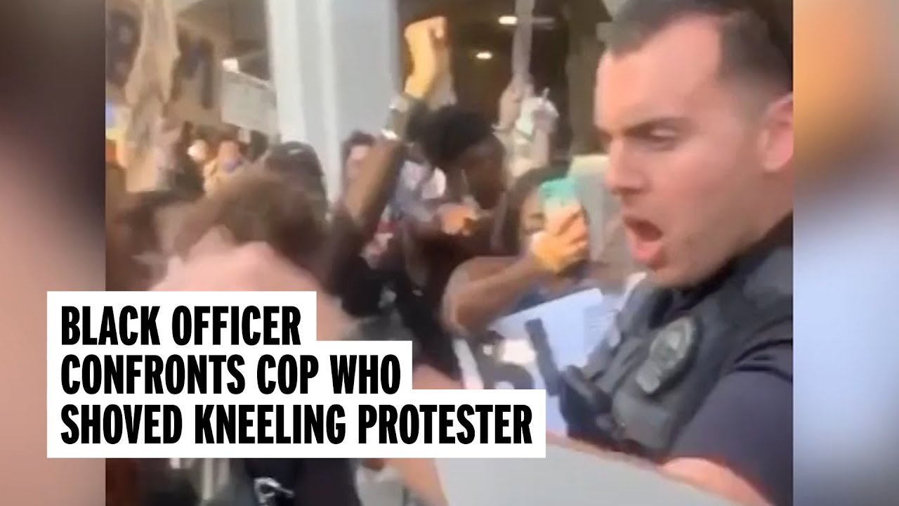 Black Officer Confronts Colleague Who Pushed Kneeling Protester | NowThis