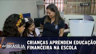 Crianças aprendem sobre educação financeira na escola   Jornal SBT Brasília 21/05/2018