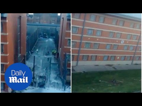 2016: Prisoners are moved out of HMP Birmingham following riots - Daily Mail