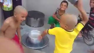 funny kids are beating each other