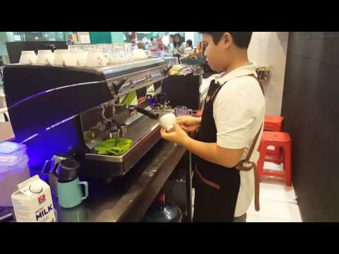 Matthew making cappuccino with latte art @kedai coffee kds Bojonegoro, east java, Indonesia