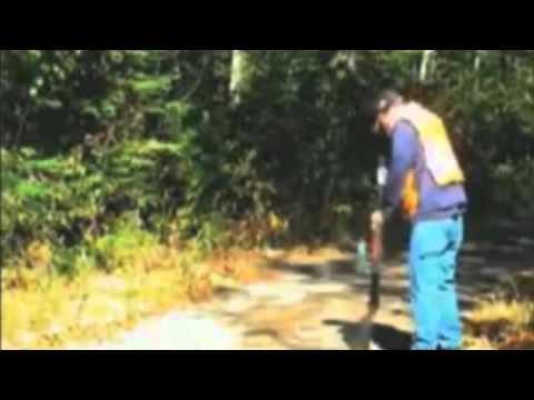 Hangfire: Man shooting shotgun has hangfire, looks down barrel of gun, and almost shoots head off