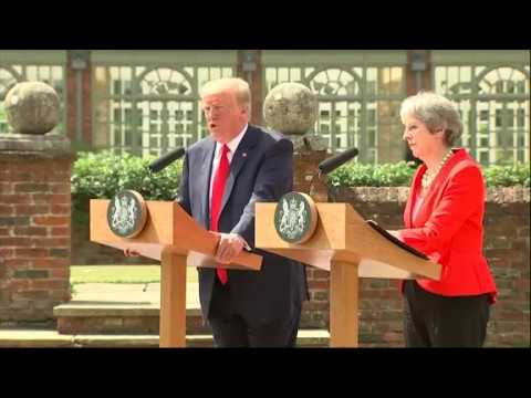 U.S. President Donald Trump is asserting that he didn't criticize British Prime Minister Theresa May during an interview this week with The Sun newspaper in which he questioned May's handling of Brexit. (The Associated Press)