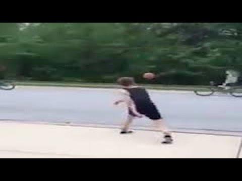 Boy Knocks Girl Off Bike With Basketball (VIDEO)