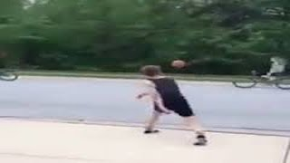 Boy Knocks Girl Off Bike With Basketball (VIDEO)