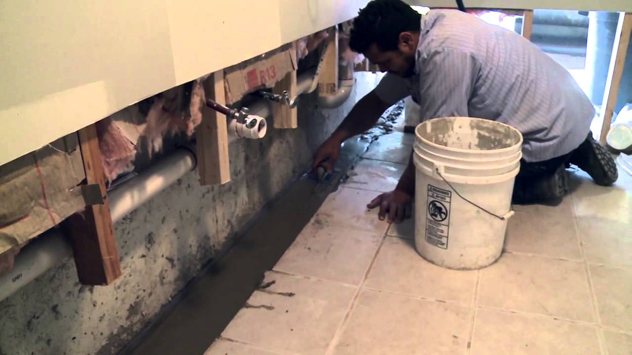 interior drain basement a watch tile youtube video waterproofing