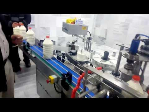Otomatik çiğ süt dolum,kapatma ve etiketleme makinesi. 3-5 lt. 5 ton saat.