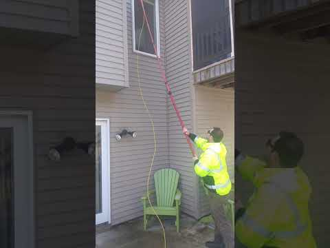 How the professionals clean high windows without a ladder