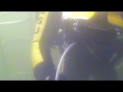 Divers see bodies in sunken ferry, can't reach them
