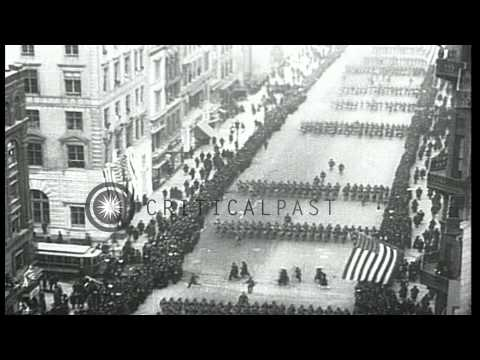 Crowd including veterans of Civil War and Spanish American War watch troops parad...HD Stock Footage