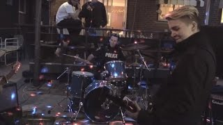 Police Officer Responding to Noise Complaint Jumps on Drums for Jam Session