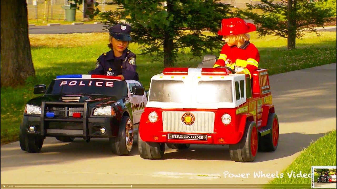 kids police car vs fire engine power wheels race youtube