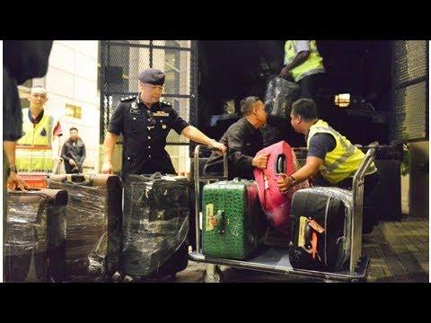 Malaysian police seized luxury bags, cash and jewelry to probe former Prime Minister Najib Razak