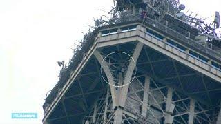 Zenuwslopende beelden: man beklimt Eiffeltoren via buitenkant