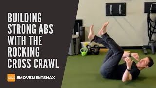 Building Strong Abs with the Rocking Cross Crawl