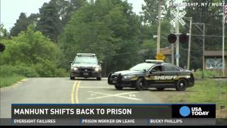 Manhunt for escaped killers shifts back to prison area