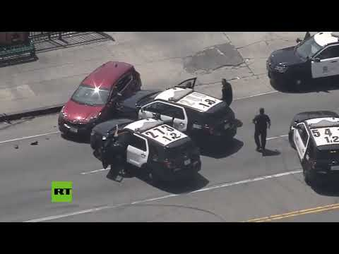 Los Angeles police chases and rams stolen vehicle suspect