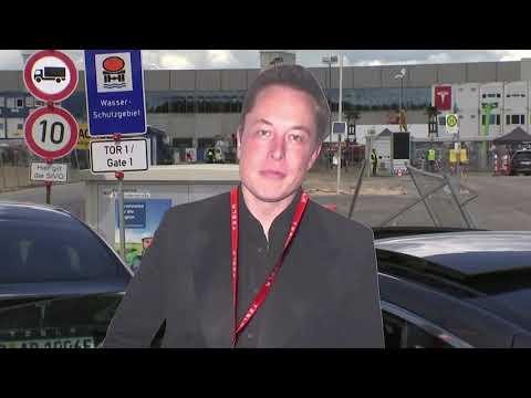 Elon Musk presented with cardboard cutout of himself by fan