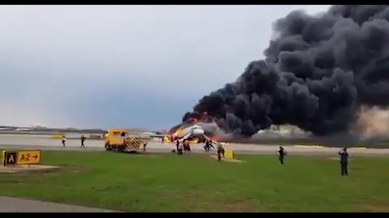 Russian plane lands in flames, killing 13