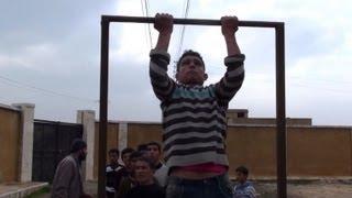 Syria rebels train 'killing machine' teenagers