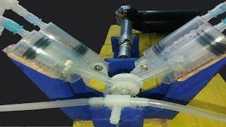 Hoe maak je een krachtige compressor van de lucht van V4 met behulp van een spuit.