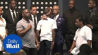 Stephon Clark's brother has tense moment with Al Sharpton - Daily Mail