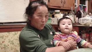 Cute baby being silly with Grandma