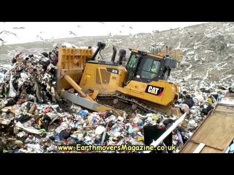 Cat D7E Hybrid dozer in landfill