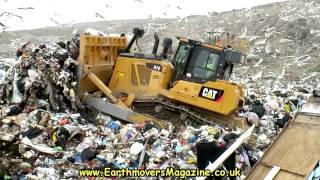 Cat D7E Hybrid dozer in landfill