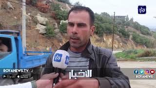انهيار جزئي بمحاذاة شارع يؤدي إلى مدرسة في منطقة نحلة - (9-12-2018)