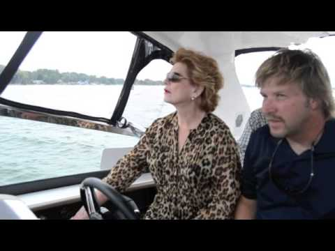 Senator Debbie Stabenow test drives boat on Lake Cadillac
