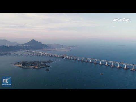 China completes main structure of world's longest cross-sea road-rail bridge