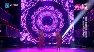 This dance took place in China and the dancers are Chinese.The Chinese have taken Baratha Natyam to