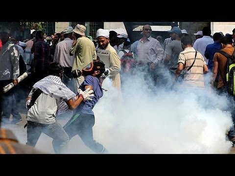 Clashes erupt in Cairo as police break up Mursi march