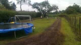 7yr old drifting aeon cobra quad bike in the mud