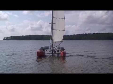 Folding catamaran sailing.
