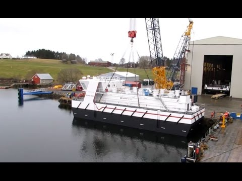 Launching feeding barge for aquaculture industry