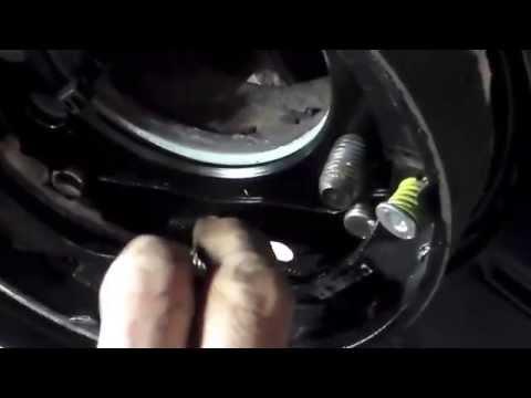 install 2005 dodge caravan rear wheel bearing and parking brake pads