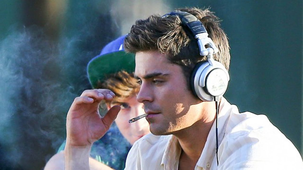 Zac Efron smoking a cigarette (or weed)