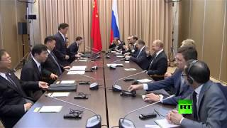 إثر تأخر الوفد الصيني بوتين يمازح رئيسها: