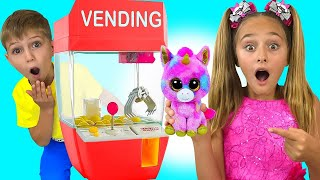 Sasha and Yarik play with giant vending machine   Stories about toys for kids