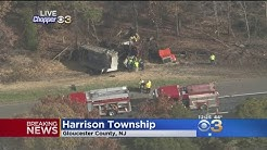 Dump Truck Overturns Into Woods On Route 55