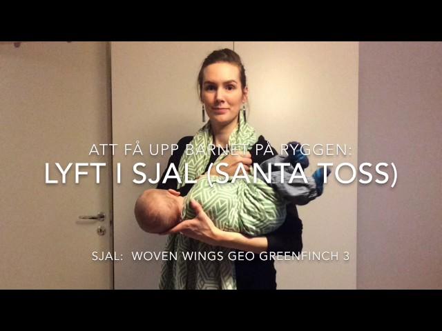 Att få upp barnet på ryggen: Lyft i sjal (Santa toss)
