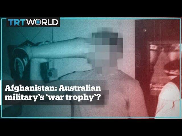 Australian soldier drinks beer out of dead Afghan militant's prosthetic leg