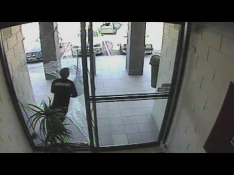Amazing CCTV: Bag thief smashes through glass door during escape