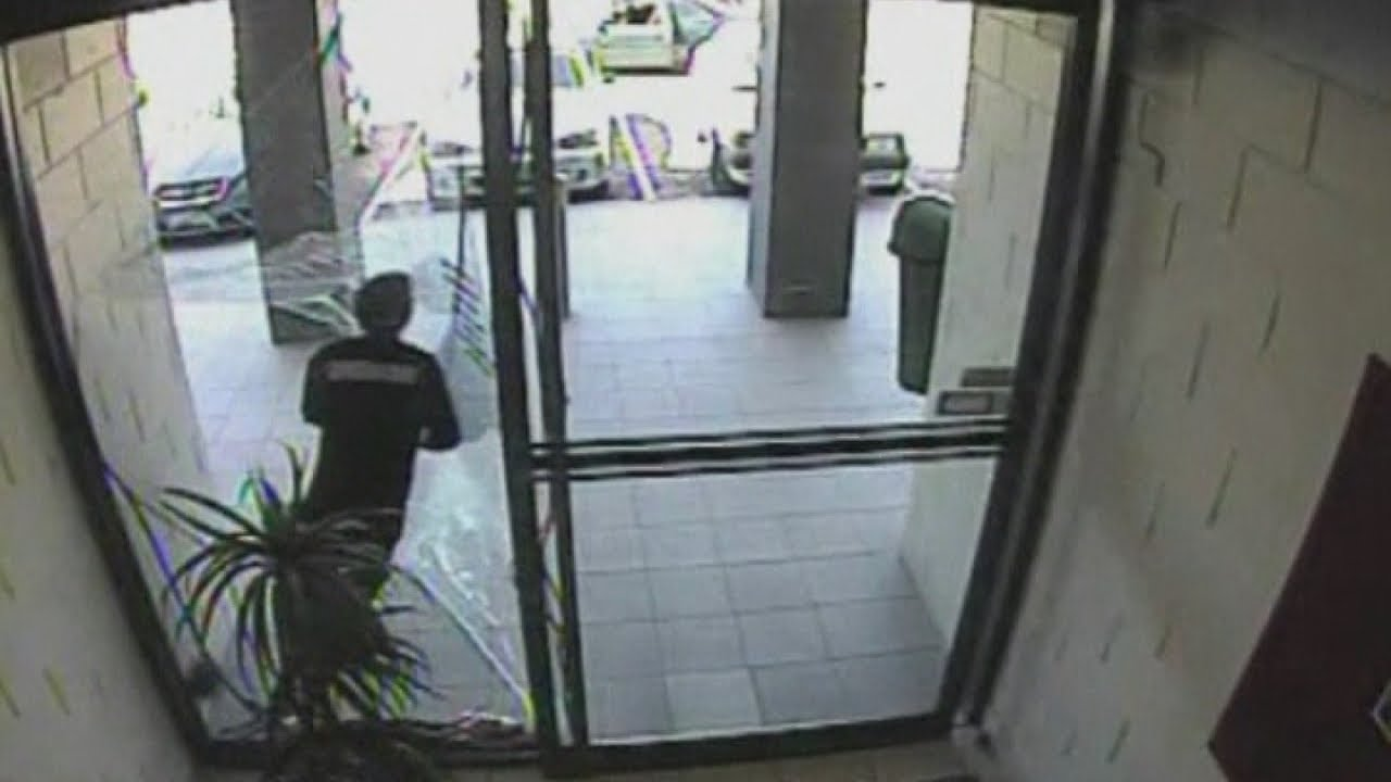 Amazing Cctv Bag Thief Smashes Through Glass Door During Escape You